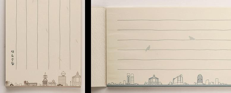 """昭和の銀座の懐かしい街並みが描かれた(左)と、銀座四丁目交差点の""""今""""を描いた(右)一筆箋 銀座418円。"""