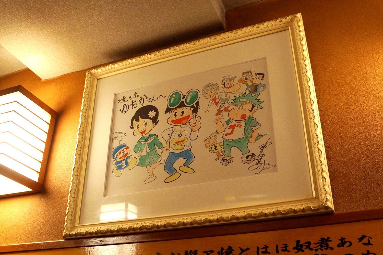 常連だという漫画家・吉沢やすみ先生のサイン。丁寧な筆致に、どれだけこの店を好きかが現れているようだ。