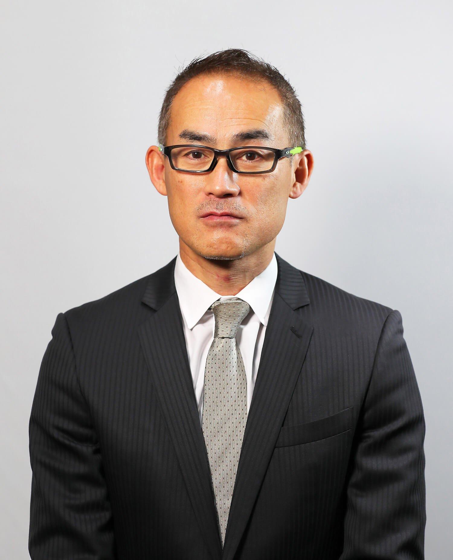 日本陸上連盟経営企画部長の石井朗生さん。学生時代は十種競技選手だった。「陸上は人間が持つ根源的な力を競うことが醍醐味です」。