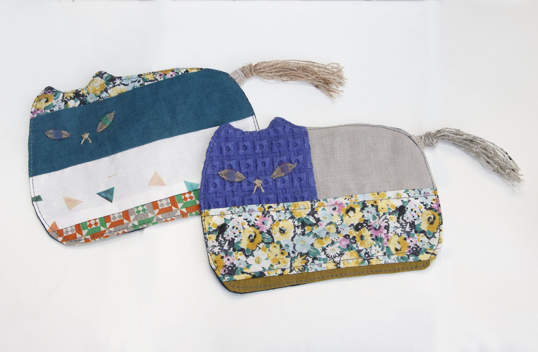 Pienaさんの猫コースター各1000円。九州の布もの作家によるパッチワーク作品。布の組み合わせが絶妙で、小皿も置けるくらいの大きさがいい。